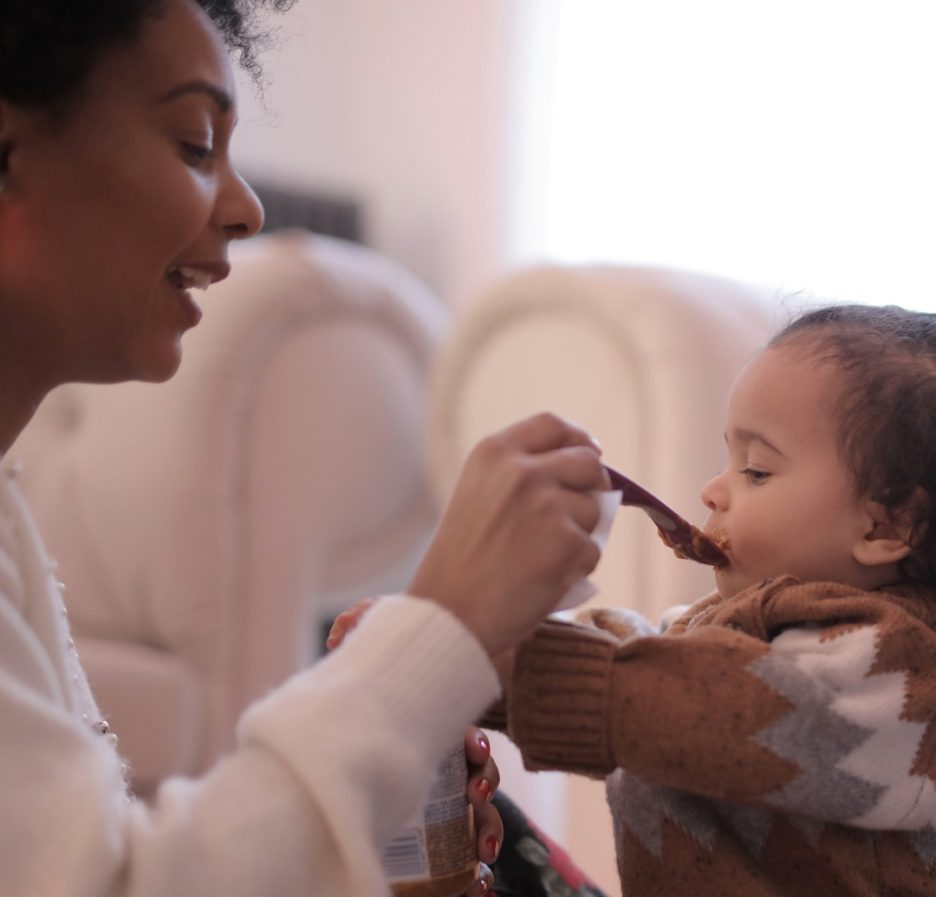 Baby being fed by her mommy
